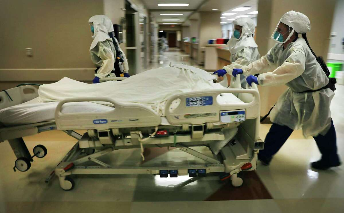 Dr. Tamara Simpson and two nurses rush a COVID-19 patient to Northeast Baptist Hospital's COVID Unit in San Antonio.