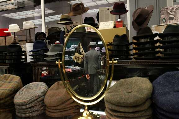 Aaron Eng, 30, looks through clothing in Cable Car Clothiers Nov. 6, 2014 in San Francisco, Calif. Cable Car Clothiers was founded in 1946 in San Francisco by Charlie Pivnick.