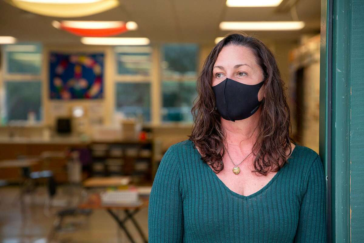 Cindy Evans, a middle school special education teacher, in the doorway of her classroom at San Jose Middle School in Novato.