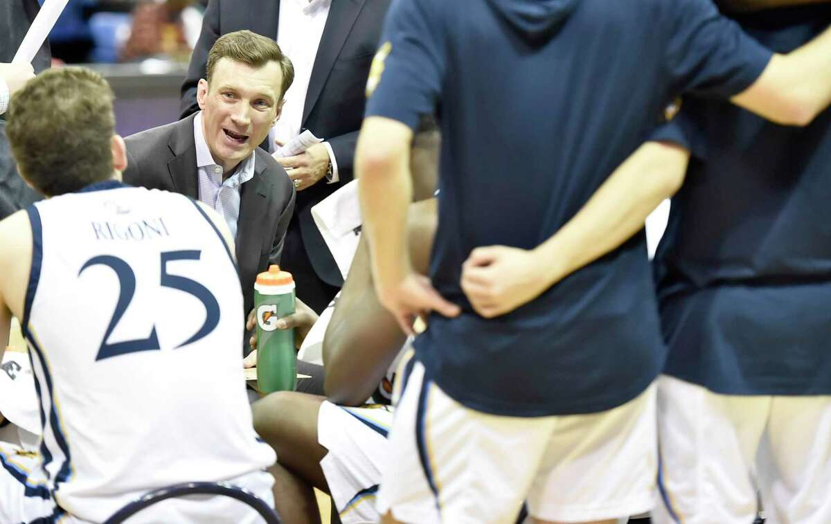 Quinnipiac University men's coach Baker Dunleavy with his team against Fairfield in January.