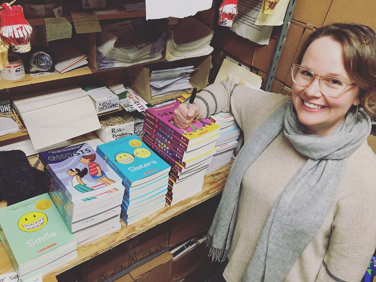 Author Raina Telgemeier signs copies of her graphic novels at Green Apple Books in San Francisco.
