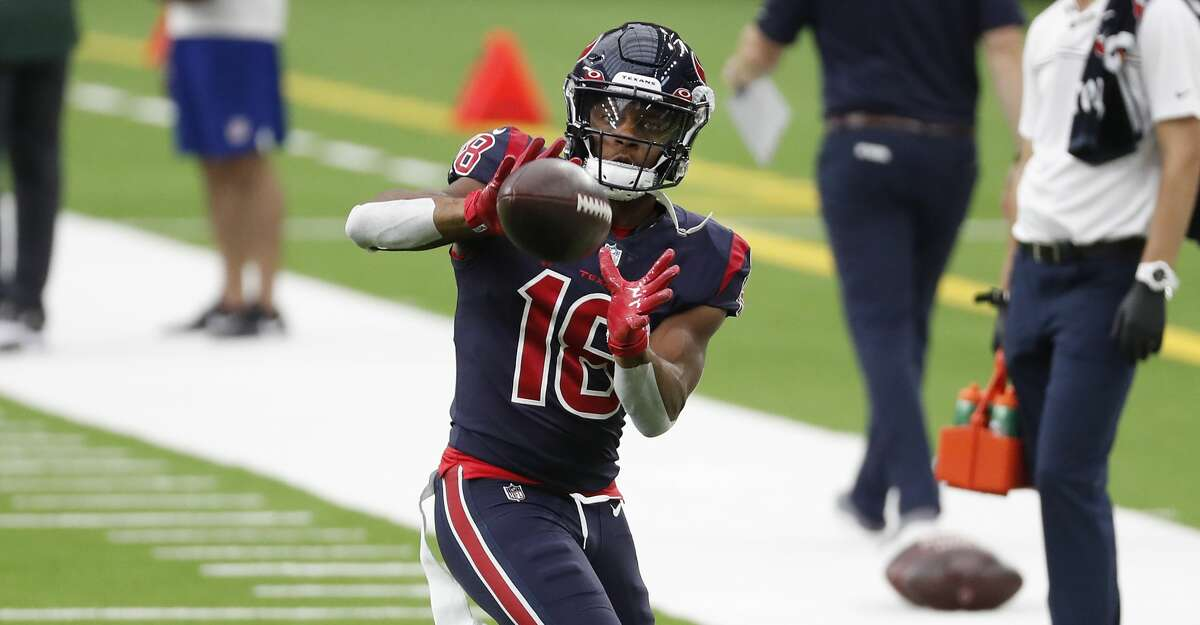 Houston Texans wide receiver Randall Cobb (18) reaches out to catch a football while warming up before an NFL football game against the Green Bay Packers at NRG Stadium on Sunday, Oct. 25, 2020, in Houston.