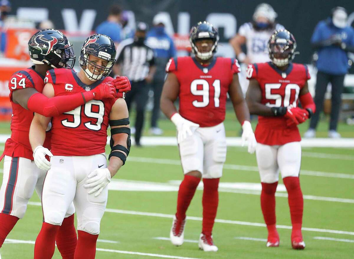 Houston Texans defensive end Charles Omenihu (94) hugs J.J. Watt (99) after a play during the first half of an NFL football game at NRG Stadium, Sunday, December 6, 2020, in Houston.