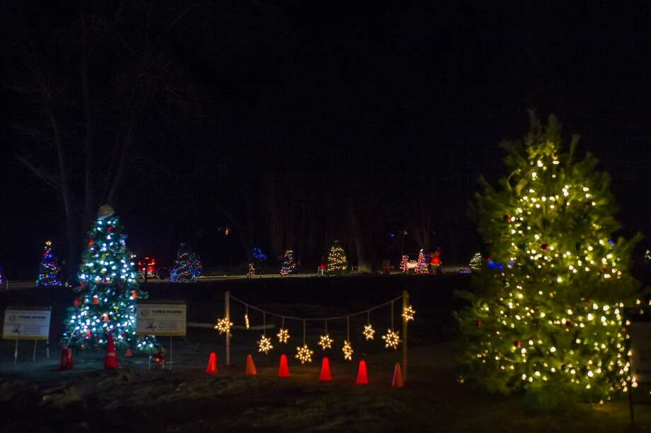 Hundreds of vehicles line up to view the Sanford Lit Christmas Tree Memorial, which features over 60 decorated trees in the area south of the rail trail, Friday, Dec. 11, 2020 in downtown Sanford. (Katy Kildee/kkildee@mdn.net) Photo: (Katy Kildee/kkildee@mdn.net)