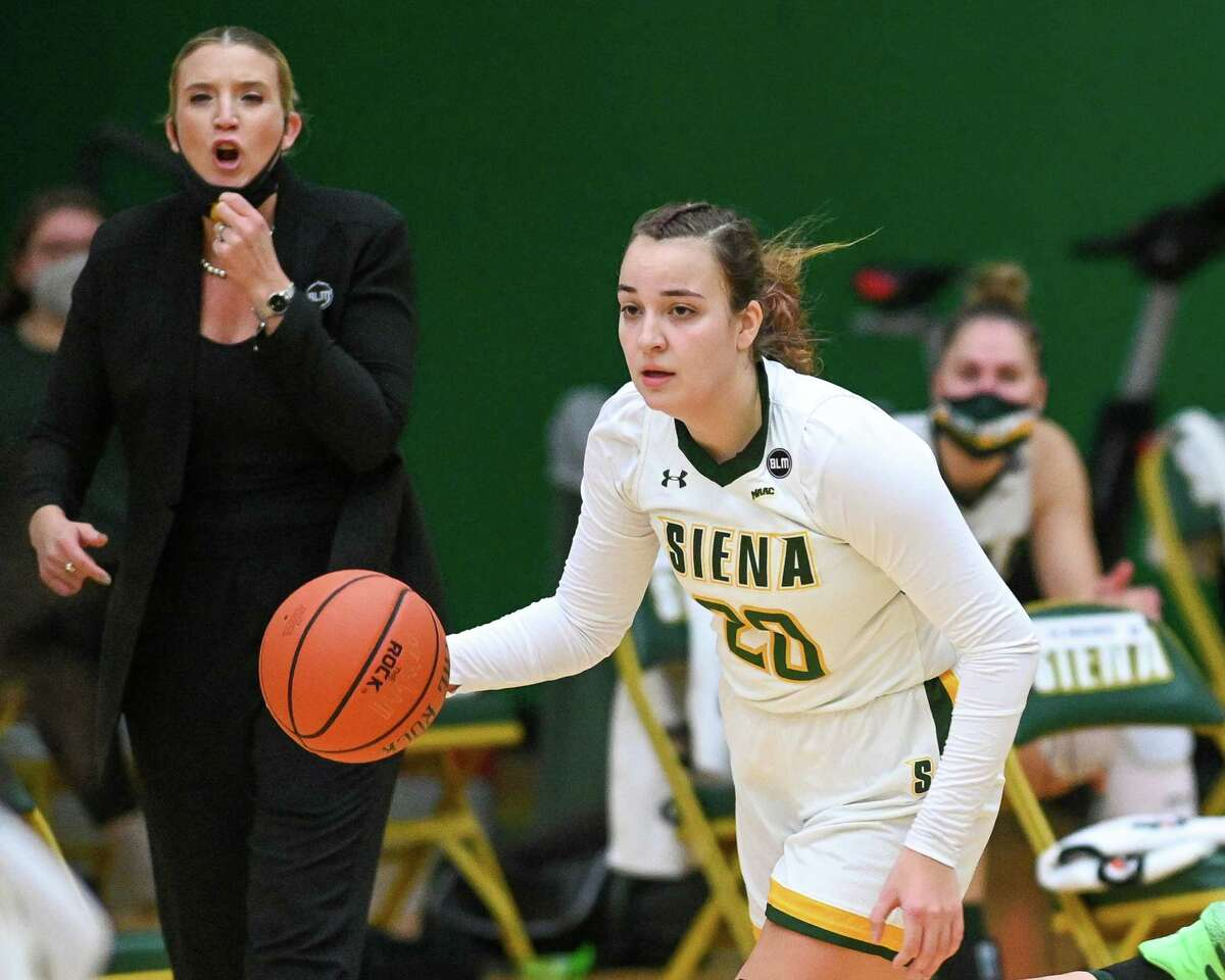 Siena College junior Margo Peterson dribbles upcourt while getting directions from head coach Ali Jaques during the Metro Atlantic Athletic Conference season opener against Fairfield University at Siena College in Loudonville, NY, on Friday, Dec. 11, 2020 (Jim Franco/special to the Times Union.)
