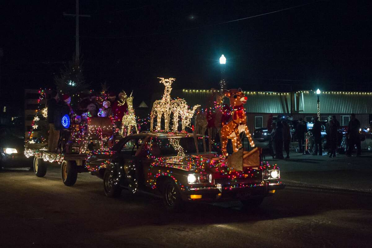 Hundreds of vehicles lined up to view the Sanford Lit Christmas Tree Memorial, which featured over 60 decorated trees in the area south of the rail trail, Friday, Dec. 11, 2020 in downtown Sanford. (Katy Kildee/kkildee@mdn.net)