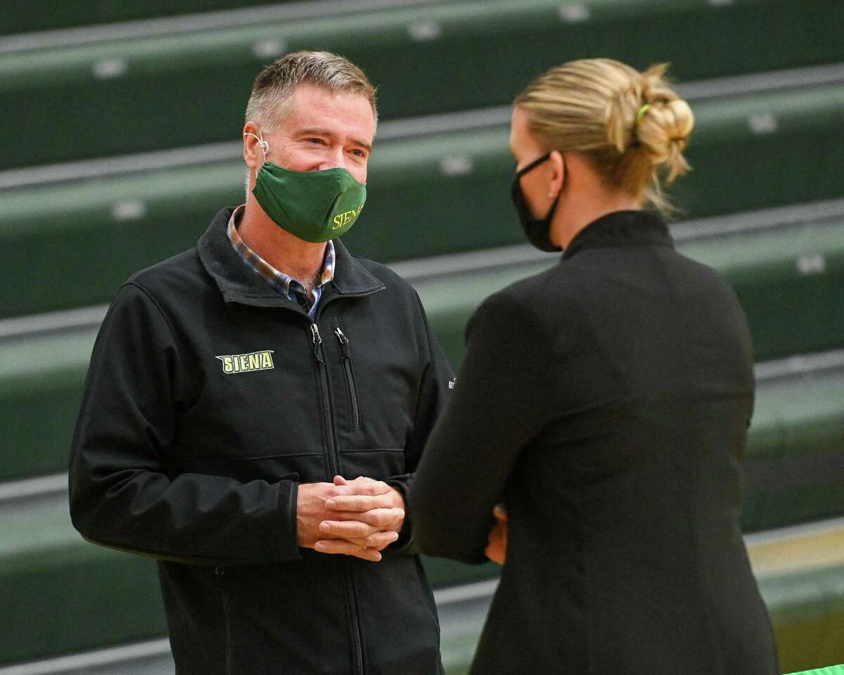 Siena College president Chris Gibson talks to womens basketball head coach Ali Jaques at Siena College in Loudonville, NY, on Friday, Dec. 11, 2020 (Jim Franco/special to the Times Union.)