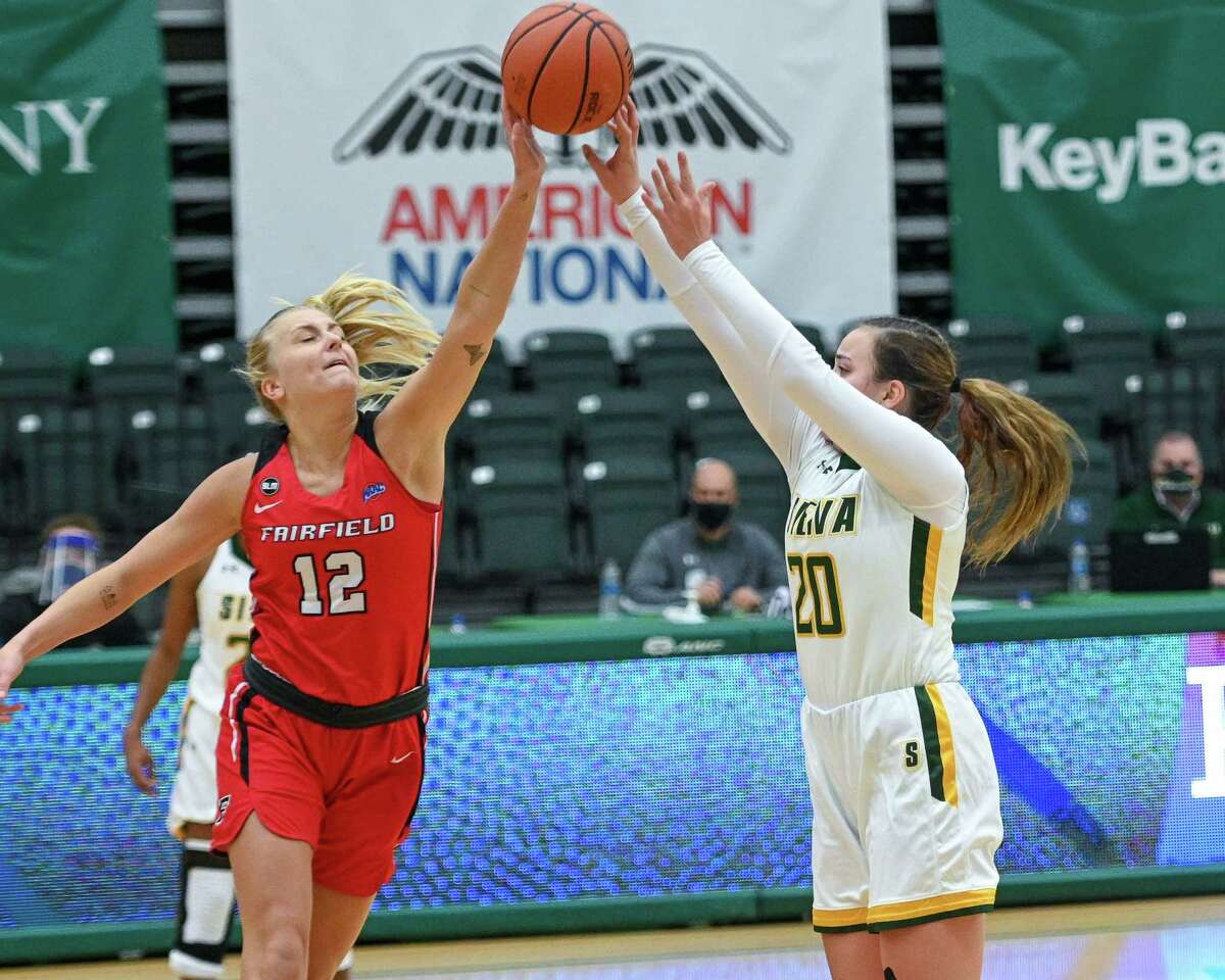 Fairfield University senior Eden Nibbelink partially blocks a jumps shot by Siena College junior Margo Peterson during the Metro Atlantic Athletic Conference season opener at Siena College in Loudonville, NY, on Friday, Dec. 11, 2020 (Jim Franco/special to the Times Union.)