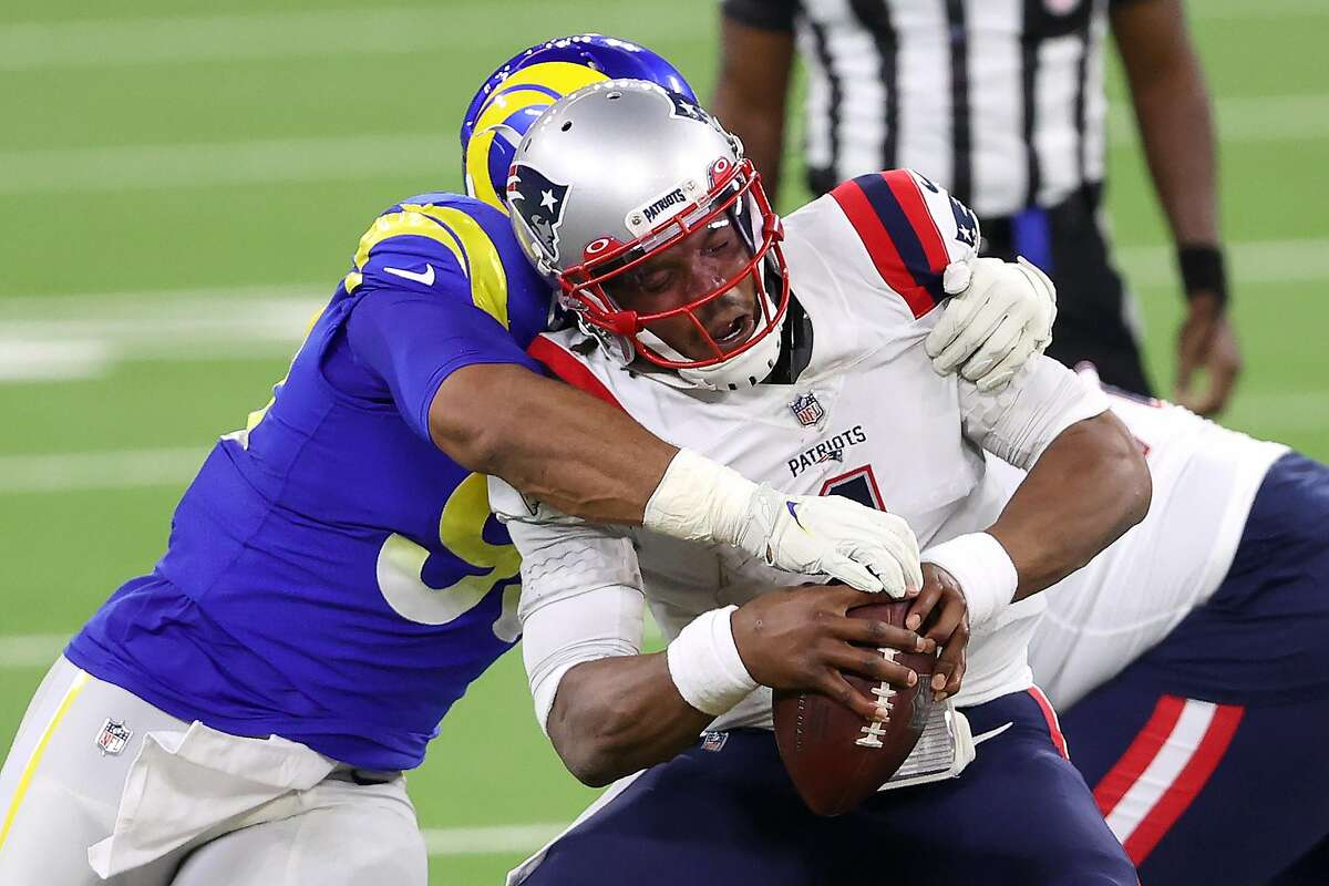 Patriots quarterback Cam Newton is sacked by Rams defensive tackle Aaron Donald on Thursday.