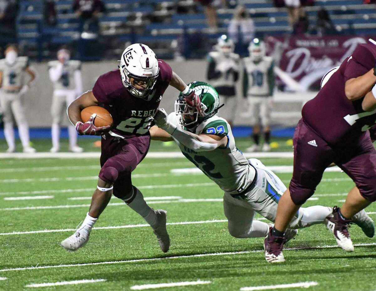 Lee's Makhilyn Young (22) attempts to evade Montwood's Matthew Enriquez (22) on Friday, Dec. 11, 2020 at Grande Communications Stadium. Jacy Lewis/Reporter-Telegram