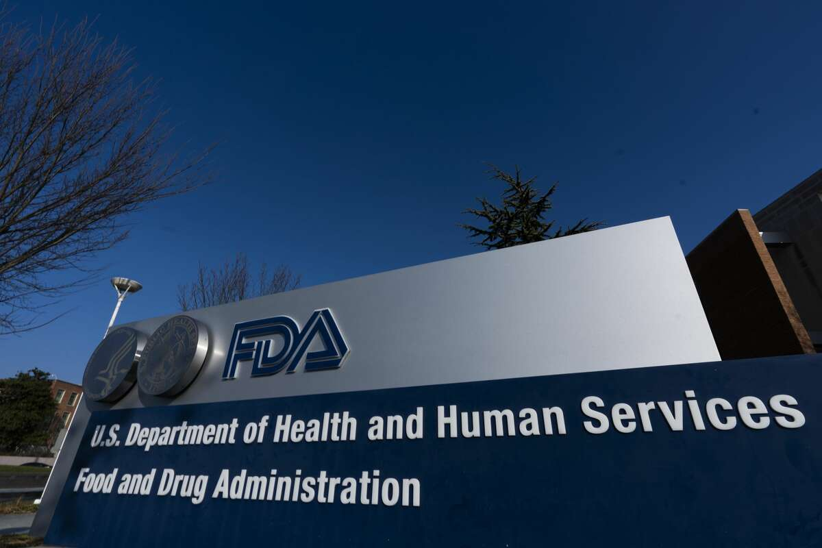 Food and Drug Administration building is shown Thursday, Dec. 10, 2020 in Silver Spring, Md. A U.S. government advisory panel convened on Thursday to decide whether to endorse mass use of Pfizer's COVID-19 vaccine to help conquer the outbreak that has killed close to 300,000 Americans. (AP Photo/Manuel Balce Ceneta)
