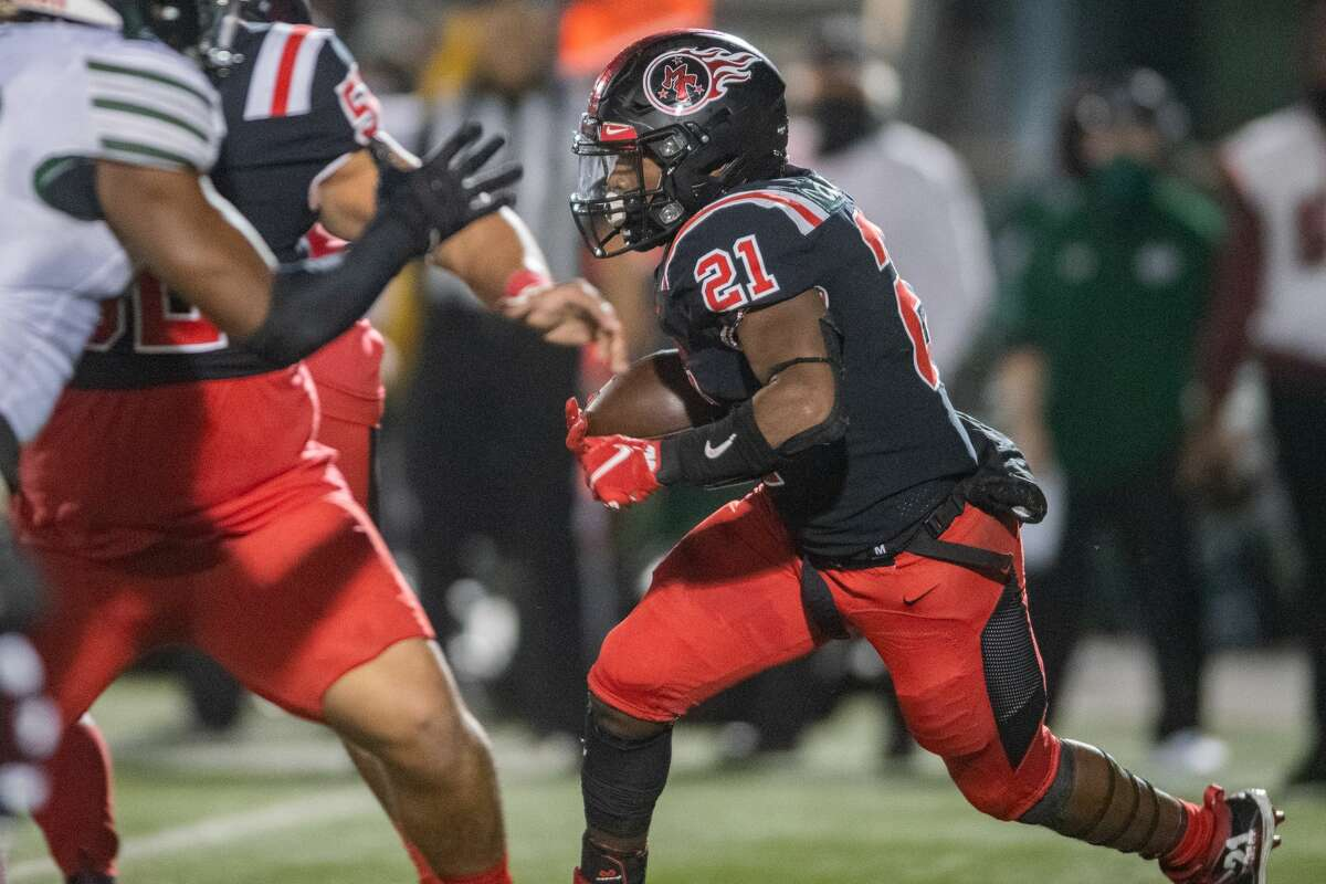 Titans Branden Chaney (21) carries the ball in the second quarter. The Port Arthur Titans battled with the Fort Bend-Hightower Hurricanes in bi-district football playoff action Friday night. Photo made on December 11, 2020. Fran Ruchalski/The Enterprise