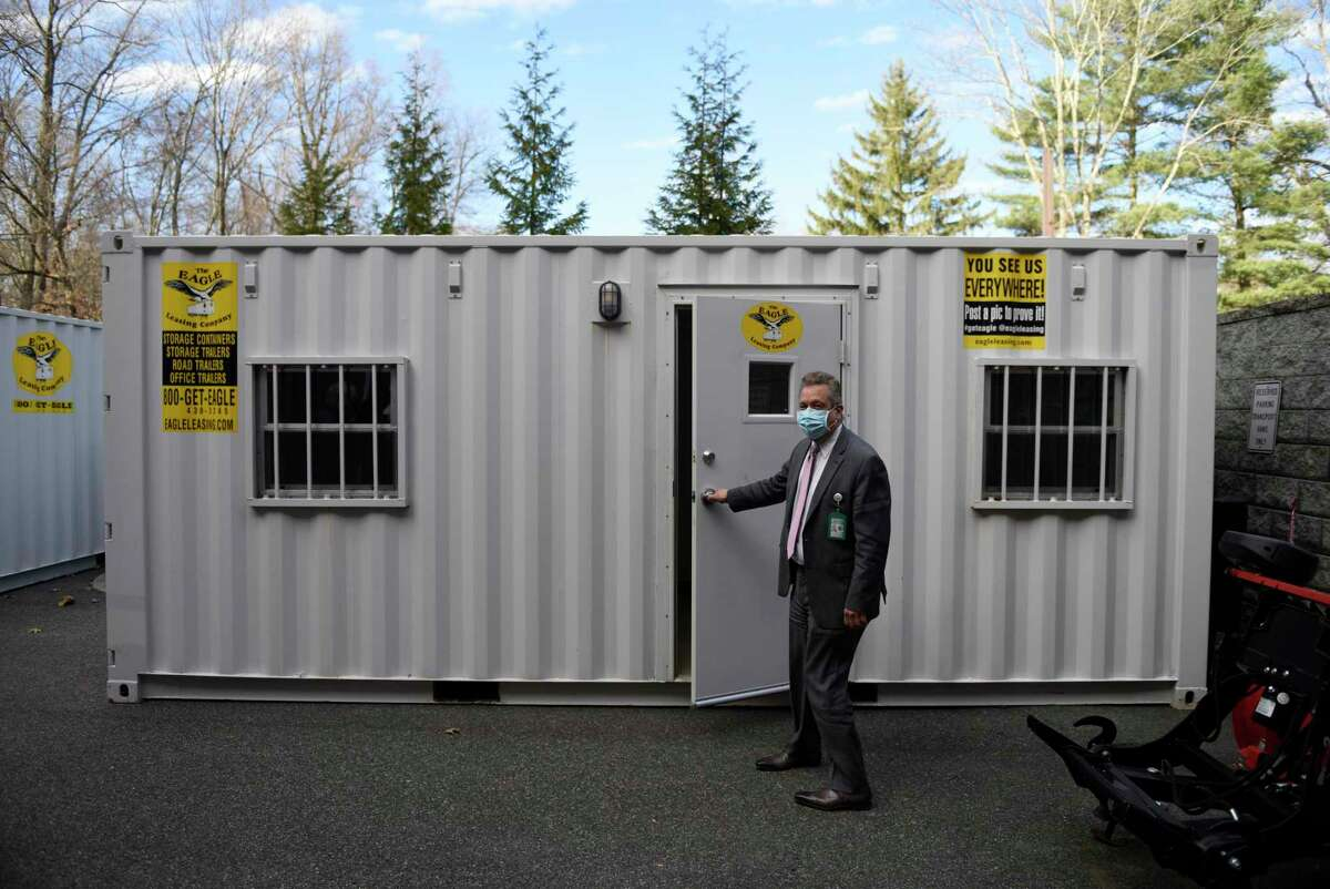 Nathaniel Witherell Executive Director John Mastronardi shows one of the new visitation pods at Nathaniel Witherell nursing and rehabilitation center in Greenwich, Conn. Monday, Dec. 7, 2020. The pods offer a safer method for friends and family to visit their loved ones staying at Nathaniel Witherell during the pandemic.