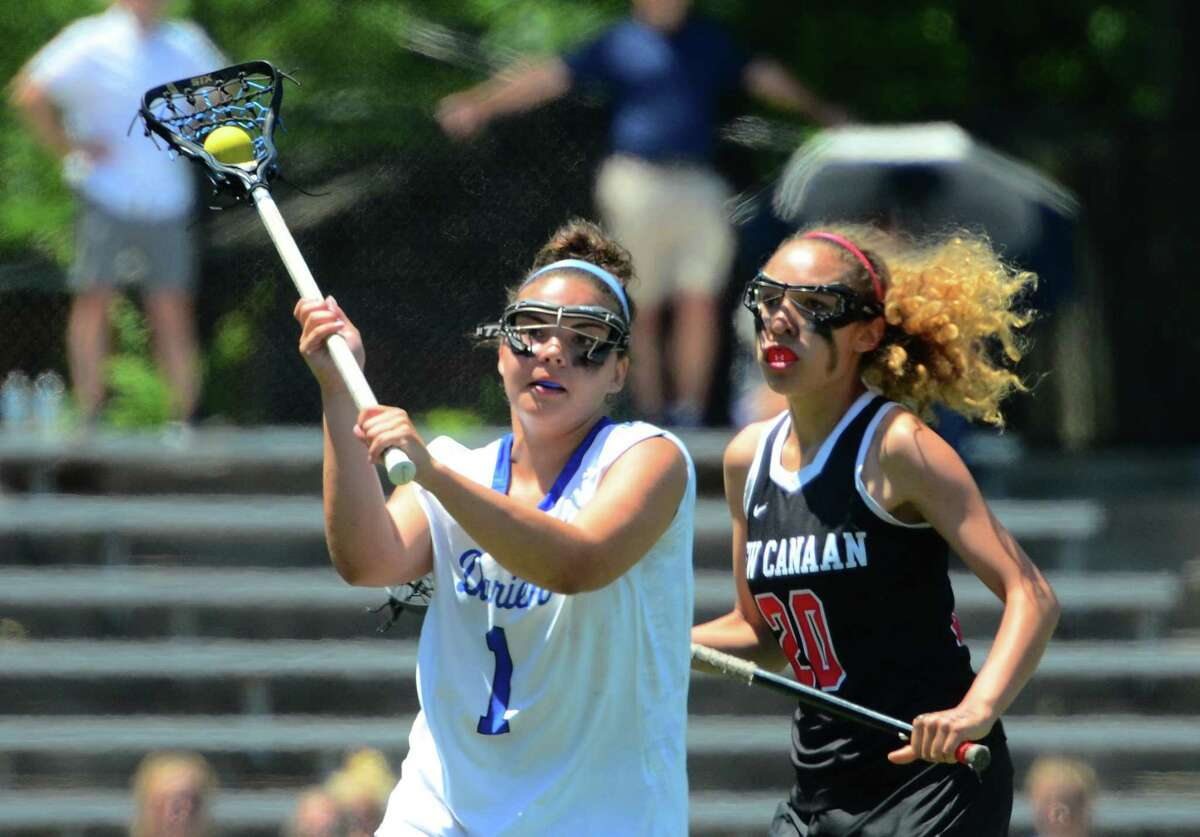 Girls Class L lacrosse action between Darien and New Canaan in Milford in 2019.