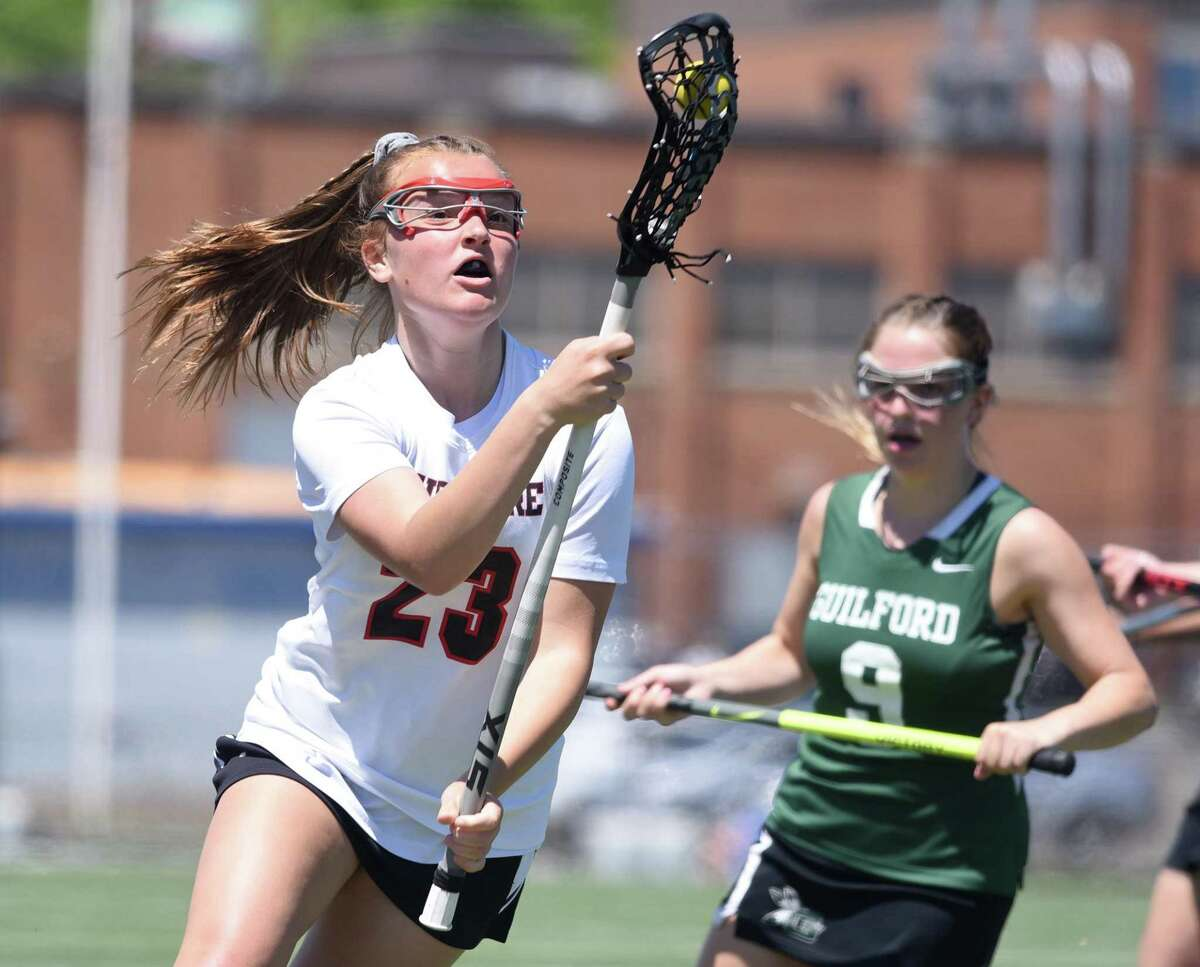 Cheshire's Kiley Jackson (23) comes up with a loose ball during the Rams' game against Guilford in the SCC girls lacrosse final at Ken Strong Stadium in West Haven in 2019.
