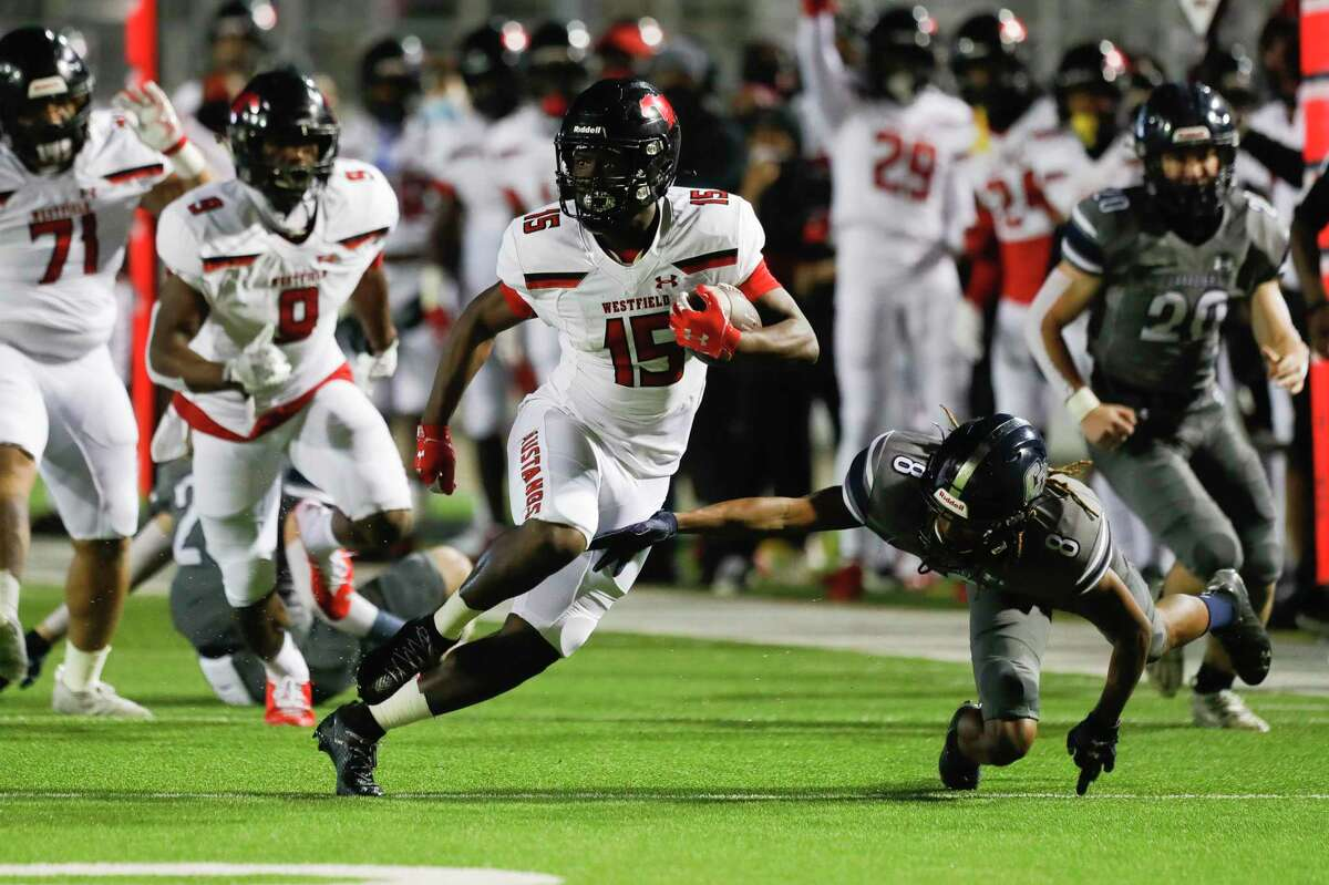 Westfield running back Rodney Smith (15) picks up a 17-yard gain as he runs past College Park defensive back Marcus Scott II (8) during the first quarter of a Region II-6A bi-district high school playoff game at Woodforest Bank Stadium, Friday, Dec. 11, 2020, in Shenandoah.