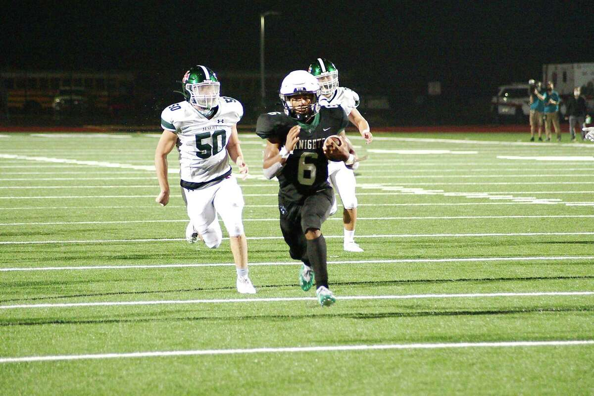 Clear Falls' David Smith (6) finds a clear path into the end zone to secure the win over Strake Jesuit Friday, Dec. 11 at Challenger Columbia Stadium.