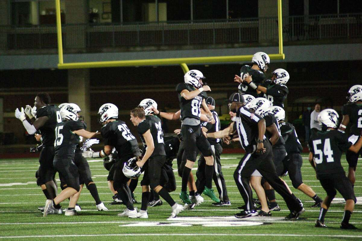 Clear Falls celebrates a victory over Strake Jesuit Friday, Dec. 11 at Challenger Columbia Stadium.