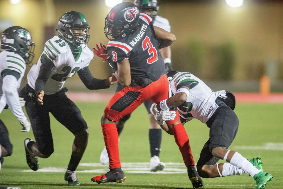 Titans Kalby Blanchette (3) struggles to get away from a tackler for more yards in the second quarter. The Port Arthur Titans battled with the Fort Bend-Hightower Hurricanes in bi-district football playoff action Friday night. Photo made on December 11, 2020. Fran Ruchalski/The Enterprise