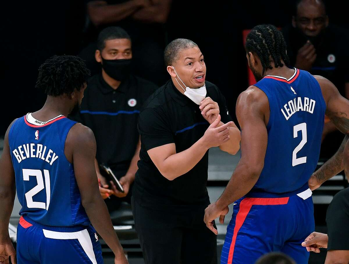 LOS ANGELES, CALIFORNIA - DECEMBER 11: Head coach Tyronn Lue of the LA Clippers speaks with Kawhi Leonard #2 and Patrick Beverley during a preseason game against the Los Angeles Lakers at Staples Center on December 11, 2020 in Los Angeles, California. (Photo by Harry How/Getty Images)