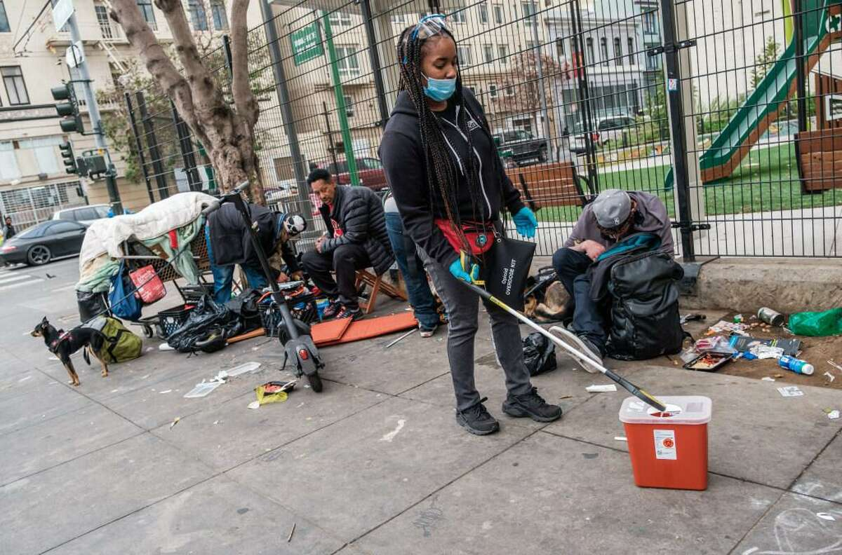 Brittaney Falley of the San Francisco AIDS Foundation picks up discarded needles, pipes and other drug paraphernalia in the Tenderloin in October.