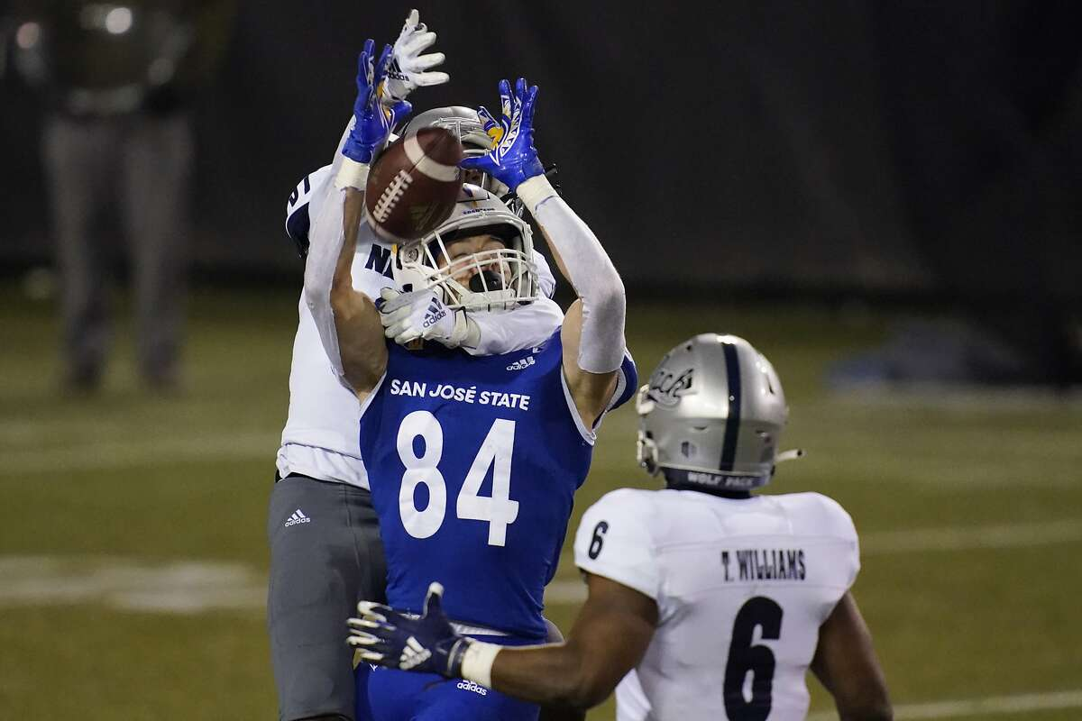 San Jose State wide receiver Bailey Gaither (84) catches a pass next to Nevada defensive back Mikael Bradford, left, during the first half of an NCAA college football game Friday, Dec. 11, 2020, in Las Vegas. (AP Photo/John Locher)