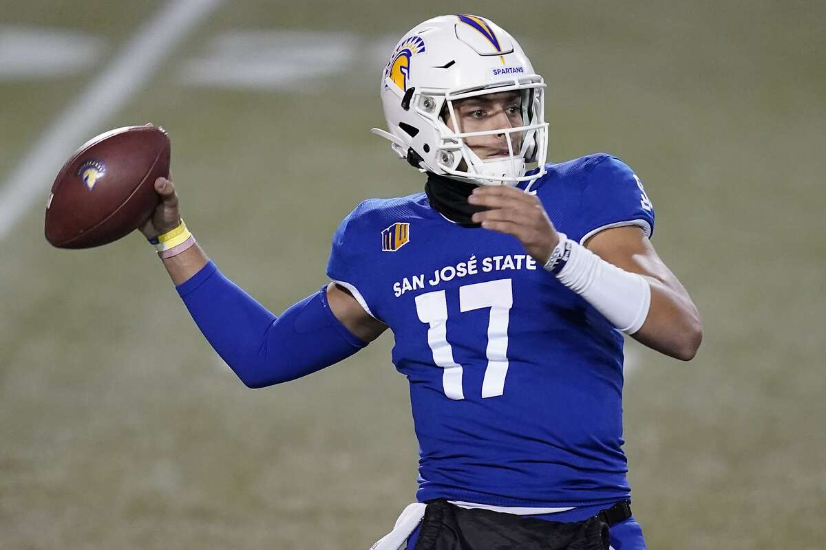 San Jose State quarterback Nick Starkel (17) looks to throw against Nevada during the first half of an NCAA college football game Friday, Dec. 11, 2020, in Las Vegas. (AP Photo/John Locher)