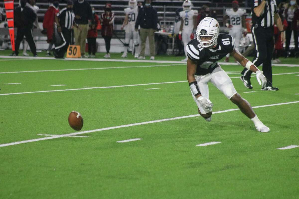 Dobie punter Jeremiah Ballard locates the football after a high snap from the center led to the team's second fumble in almost as many minutes. Atascocita recovered this football, leading to a 13-0 Dobie deficit.