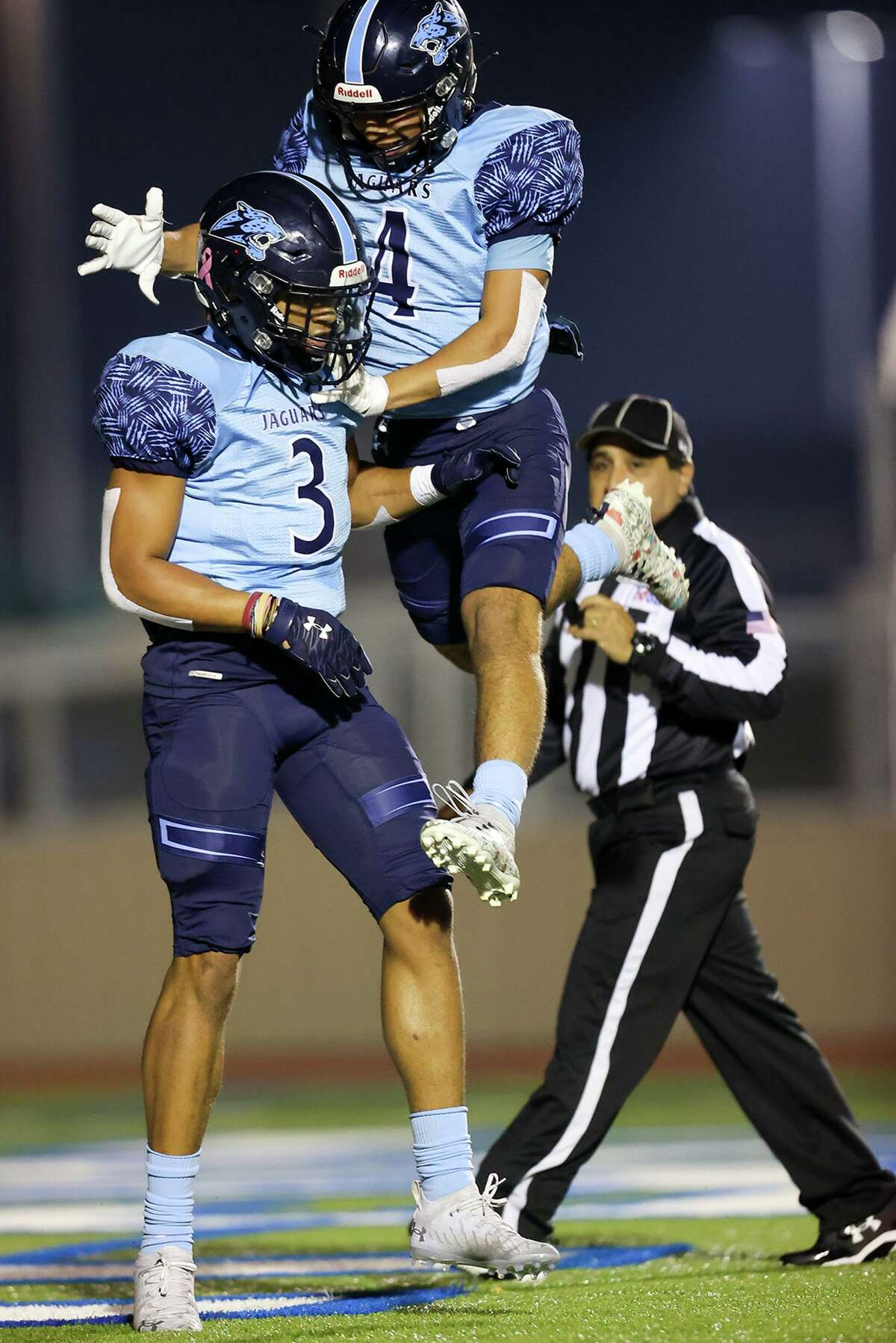 The Jaguars' Shane Johnson, left, celebrates one of his four touchdown catches with Robert Ramirez. Johnson finished with seven receptions for 212 yards.