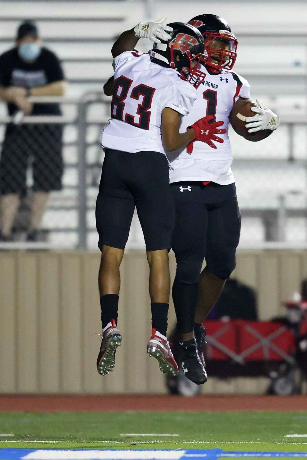 Wagner's L.J. Butler, right, celebrates a9-yard touchdown run with Donavyn Ransaw during the first half of their Class 6A, Division II first round high school football playoff with Johnson at Comalander Stadium on Friday, Dec. 11, 2020.