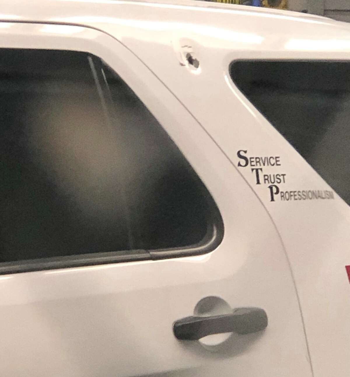 Troy police said one of their vehicles was struck by a bullet on Saturday.