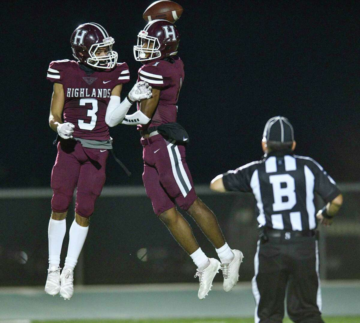 Highlands' Daaveion Holmes, right, celebrates with teammate Luis Ortiz (3) after scoring on a touchdown pass against Southwest Legacy during high school football playoffs action at Titan Stadium on Friday, Dec. 11, 2020. The ball fell incomplete.