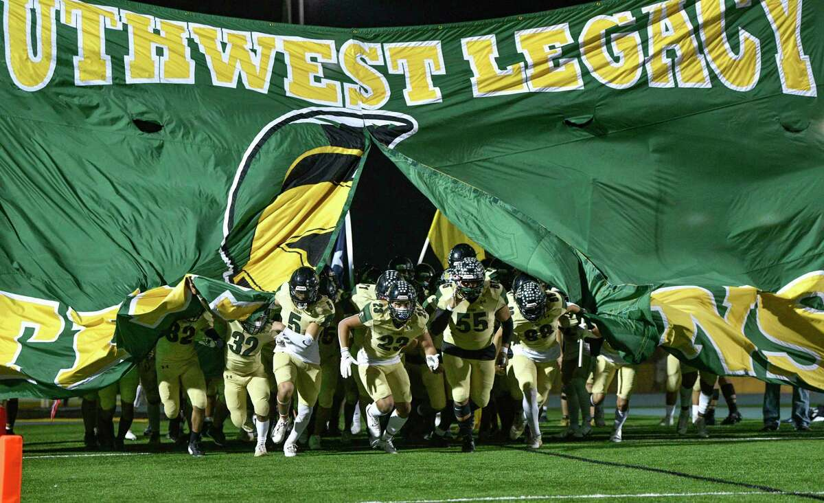 The Southwest Legacy Titans enter the field for their playoffs game against Highlands at Titan Stadium on Friday, Dec. 11, 2020.