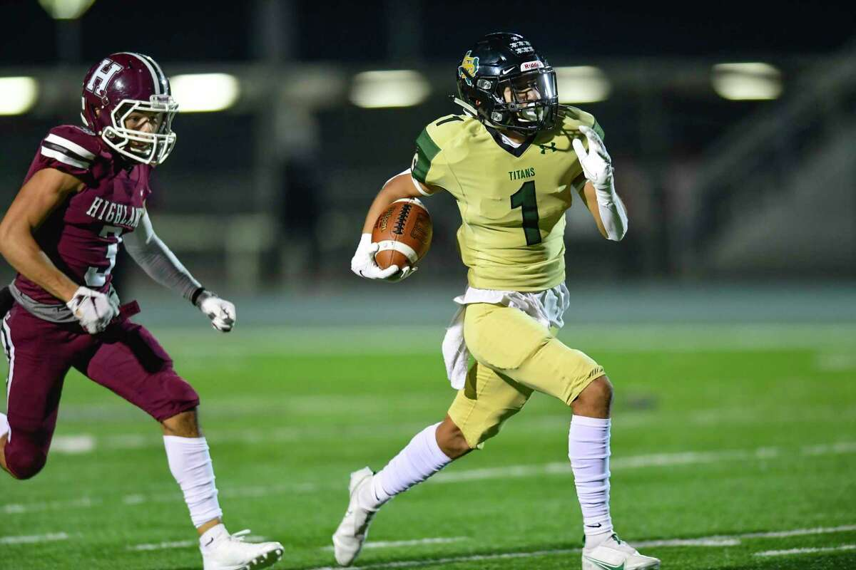 Southwest Legacy receiver Jeremiah Sifuentes runs for yardage as he is chased by Luis Ortiz of Highlands during high school football playoffs action at Titan Stadium on Friday, Dec. 11, 2020.