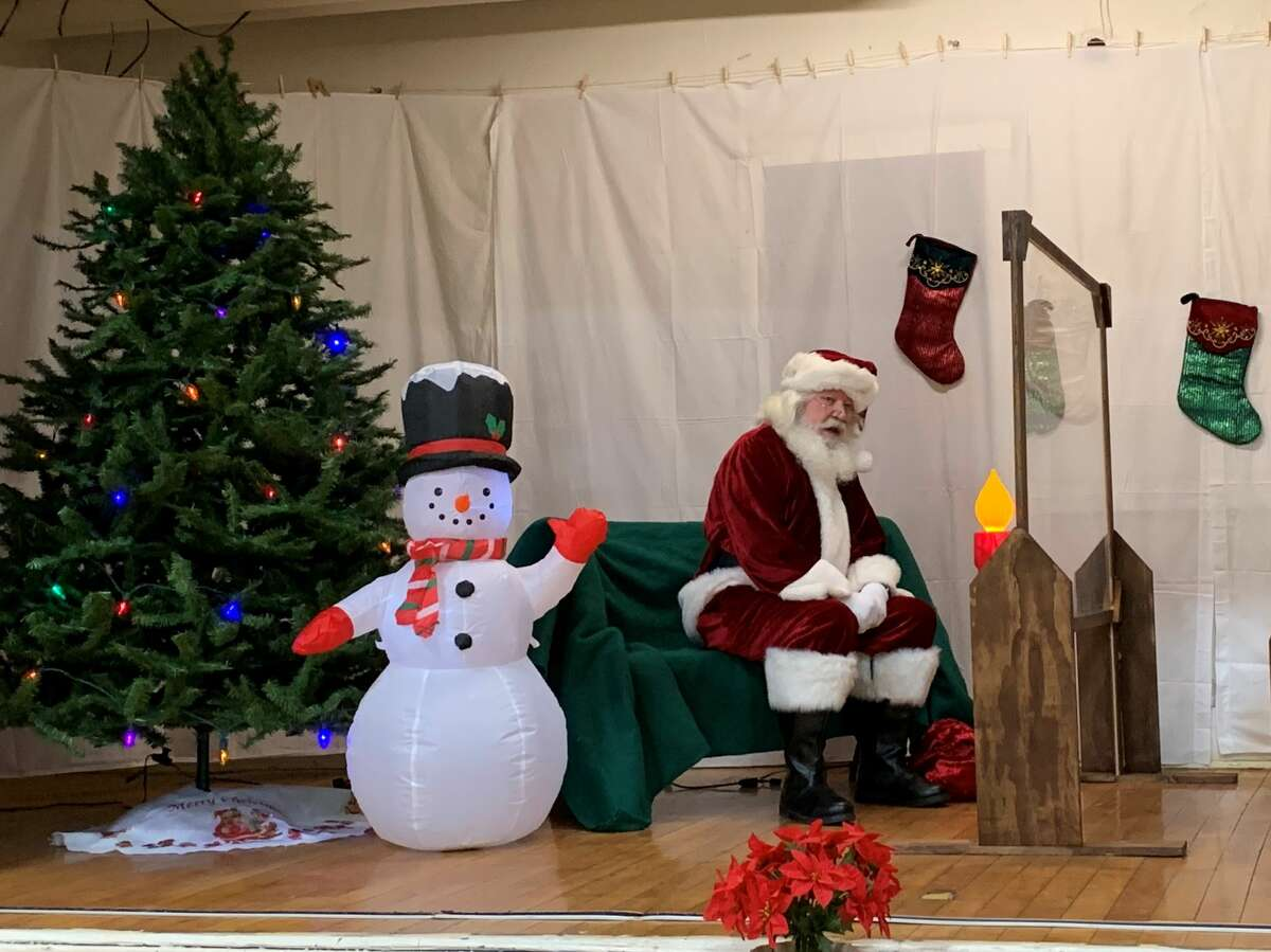 Children waited in line at the Morley Community Center on Friday for a chance to get a picture with Santa and let him know what was on their Christmas wish list. Each visitor received a goodie bag following their visit with Santa.