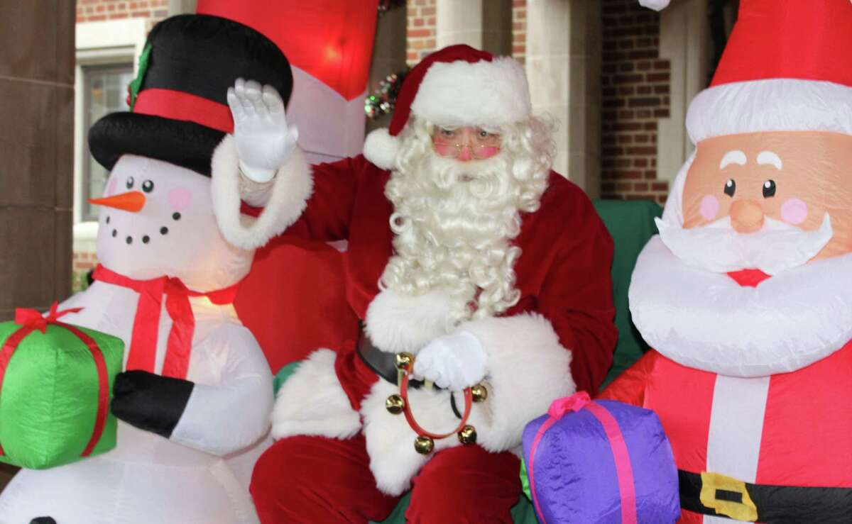 """""""Santa Claus"""" visited Waveny House Saturday morning, Dec. 12, sharing a socially distanced greeting with families as they drove though the entrance way."""