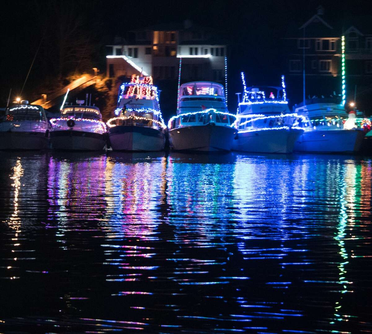 Boats lit with holiday lights in Gig Harbor.