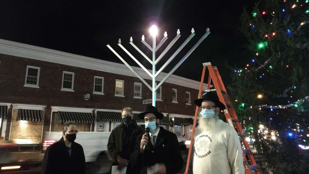 On Thursday evening Dec. 10, local dignitaries together with Bethlehm Chabad met at the Four Corners in Delmar to celebrate Chanukah and light the Menorah.From left, Bethlehem Comptroller Michael Cohen, Town Supervisor David Van Luven and Rabbi Zalman and Nachman Simon of Bethlehem Chabad.