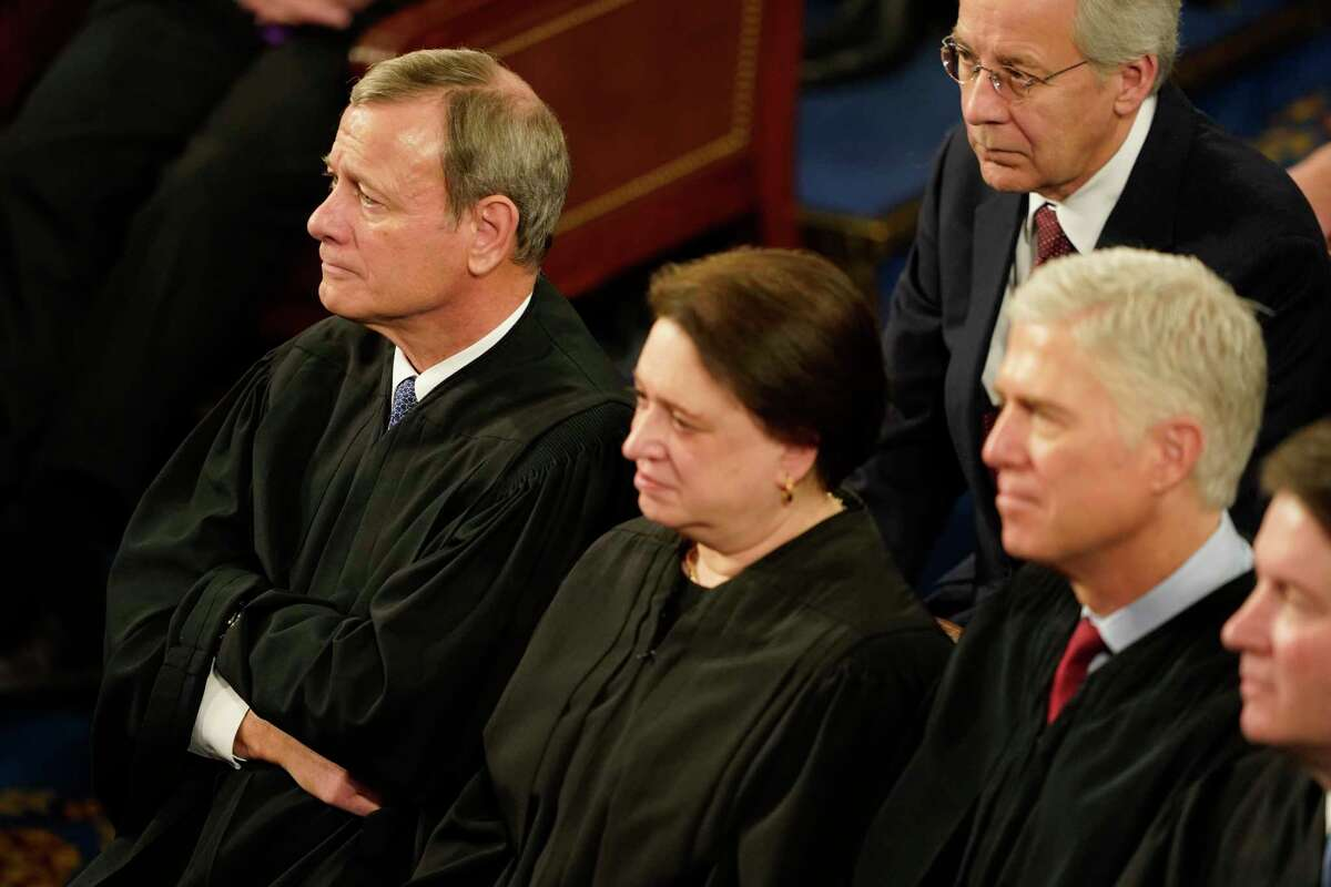 Chief Justice John Roberts and other members of the Supreme Court listen to President Trump deliver the State of the Union speech on Feb. 4, 2020.