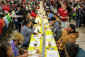 Attendees enjoy their holiday meals during the annual H-E-B Feast of Sharing event at the Henry B. Gonz‡les Convention Center in San Antonio, Texas, on Saturday, December 21, 2019. The event featured live music, photos with Santa, and flu shots. The Feast of Sharing started in 1989 and it's held in 30 cities around Texas and Mexico during the holidays. Free holiday meals including ham, mashed potatoes, green beans, and a slice of apple pie were served to an estimated 14,000 people.