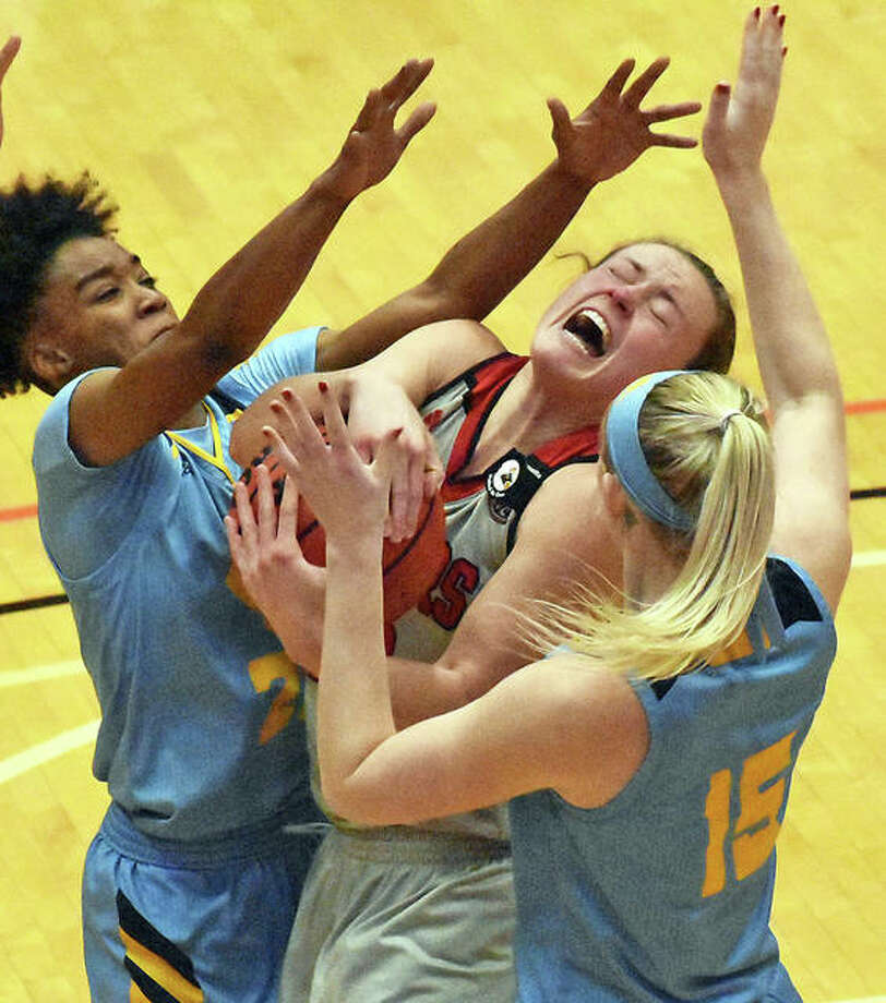 SIUE forward Allie Troeckler, center, fights for a rebound with two UMKC defenders during Saturday's game inside First Community Arena in Edwardsville.