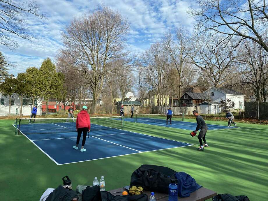 Pickleball players enjoy an extended outdoor season, thanks to unseasonably warm weather in November and December, at the recently resurfaced courts at Cosier Park, located on Wise Street in the Village of Bear Lake. (Courtesy photo)