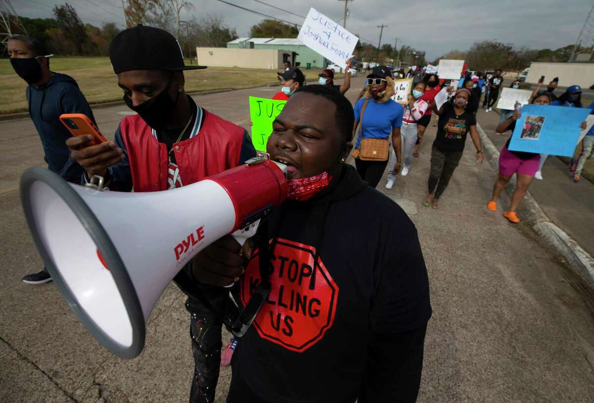 Jarrod Holt leads a chant during a march in La Marque, Texas on Saturday, Dec. 12, 2020, to protest the shooting of Joshua Feast, 22, by a La Marque police officer. Officials say Officer Jose Santos fatally shot Feast late Wednesday. (Stuart Villanueva /The Galveston County Daily News via AP)