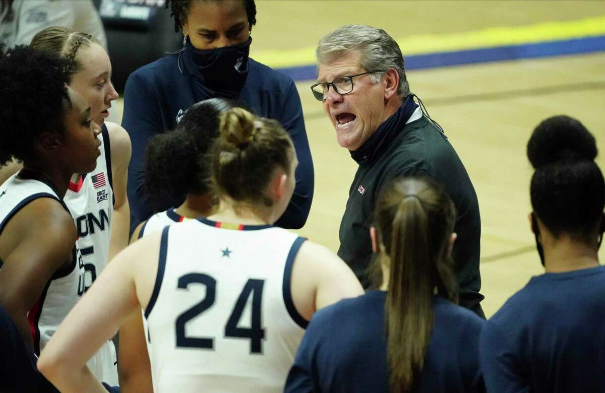 UConn head coach Geno Auriemma talks to his players during a break in the second first half of an NCAA women's basketball game against UMass-Lowell on Saturday in Storrs, Conn.
