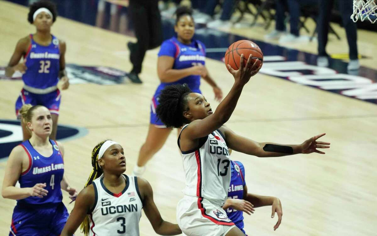 UConn's Christyn Williams (13) drives to the basket against UMass-Lowell on Saturday in Storrs.