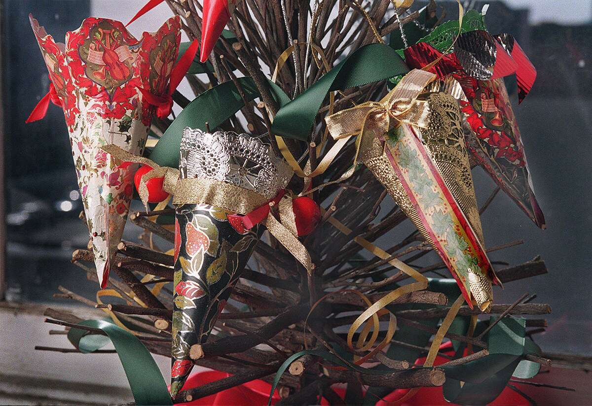 Pictured are ornaments made from wrapping paper. The Recording Secretary of the Ridgefield Democratic Town Committee, (DTC), writes an opinion in this column about what she feels voters should do.