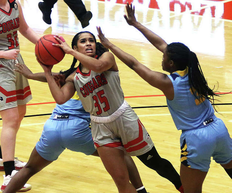SIUE's Mikala Hall (35) puts up a shot over Kansas City's Naomie Alnatas (right) after splitting defenders in the first half Saturday at First Community Arena in Edwardsville. Photo: Greg Shashack / The Telegraph