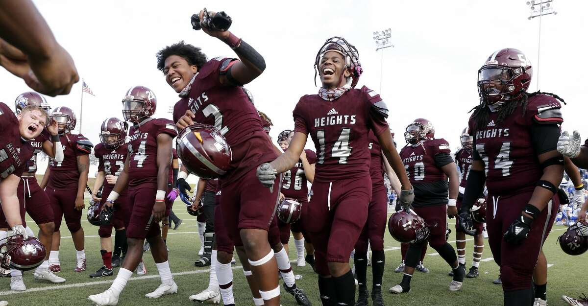 Heights players celebrate their win over Cy Creek after their 5-6A, Division 2 Bi-District high school football playoff game at Delmar Stadium Saturday, Dec. 12, 2020 in Houston, TX.