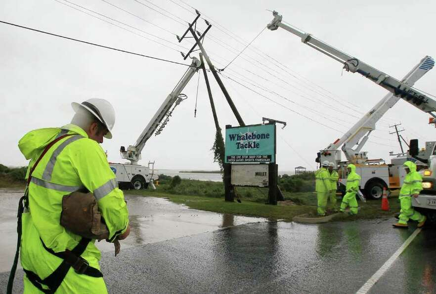 NAGS HEAD, NC - SEPTEMBER 03:  Power company crews prepare to straighten a pole that bent over due t