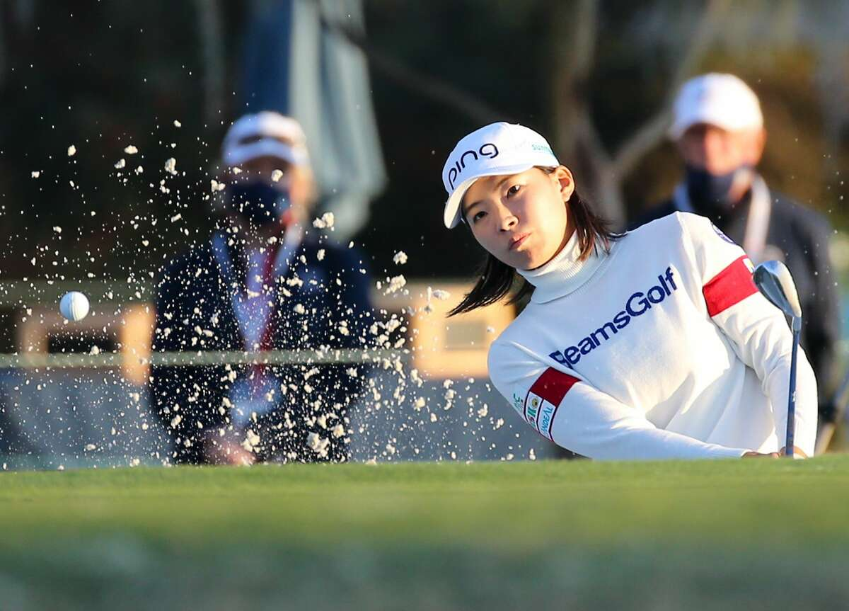 Hinako Shibuno of Japan gets the ball out of the bunker on the 18th hole during the third round of the 75th Annual U.S. Women's Open on the Cypress Creek Course at Champions Golf Club in Houston on Saturday, Dec. 12, 2020.